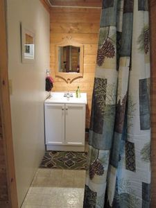 Bathroom with vanity sink and shower.