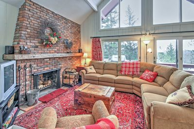 The inviting living room boasts a fireplace and floor-to-ceiling windows!