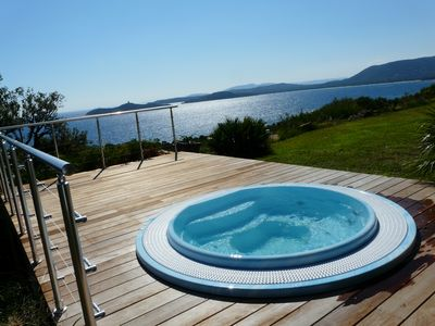 Photo for VILLA of 300 m2 very high standing on ground of 2700 m2,7 rooms, 6 sdbs, HEATED SWIMMING POOL with views of Bavella, SPA overlooking Pinarello Bay, sandy beach at 5 '