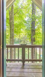 Beauty abounds right out this door! - Deck on front of home with plenty of seating during the warmer months.