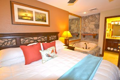 Welcome to Our Westgate Condo! Master bedroom is complimented by an en suite bathroom with jetted tub and steam/rainfall shower.