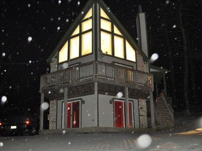 Front of chalet, evening snow.