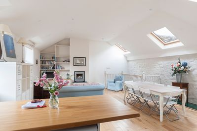 Light and bright living area on first floor with kitchen and large dining table