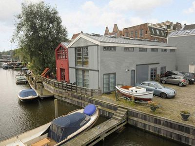 Photo for The Boat House-Off, Wooden Waterfront Office-Apartment in Centre of Amsterdam