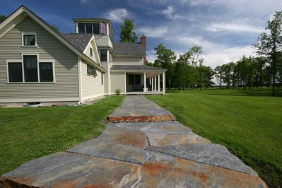 Front entry. Acres of lawn to play on: croquet, bocce, frisbee, soccer, etc.