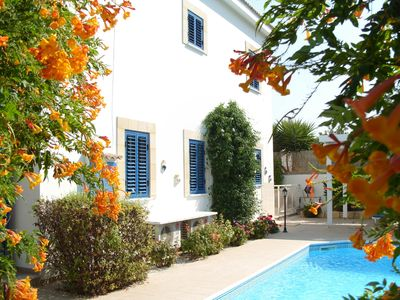 Photo for Luxury 3 bedroom villa with private pool and gardens, 5 mins walk to the beach