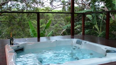 58 Jet massaging spa set among gumtrees & tropical plantings