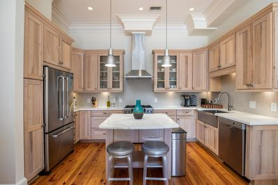 Gracious Fully Equipped Kitchen With Stainless Appliances & Seating For Two