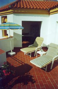 Large sunny s/west facing terrace shaded room with seating for eating al fresco.