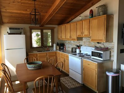 Fully remodeled kitchen with microwave, coffee maker,toaster comfortably seats 6