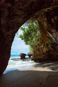 The Cove walk-through grotto at the West side of the beach
