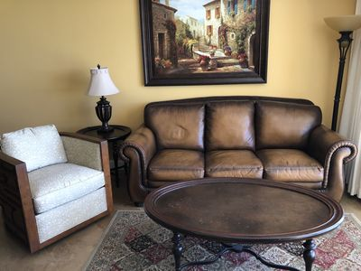 Living area with a leather queen sleeper sofa.