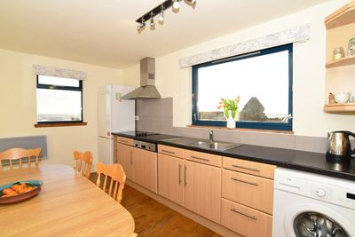 Large well equipped kitchen with seating for 6