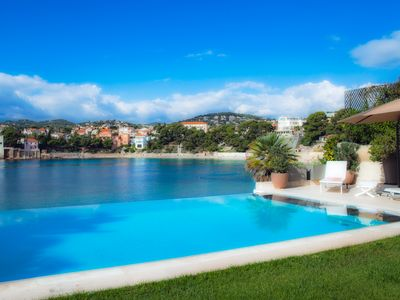 Photo for EXCEPTIONAL Luxury villa, feet in the water on the beach of Renecros