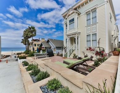 Photo for Rooftop deck, Garage parking, Steps to the sand, Walk to shops and restaurants!