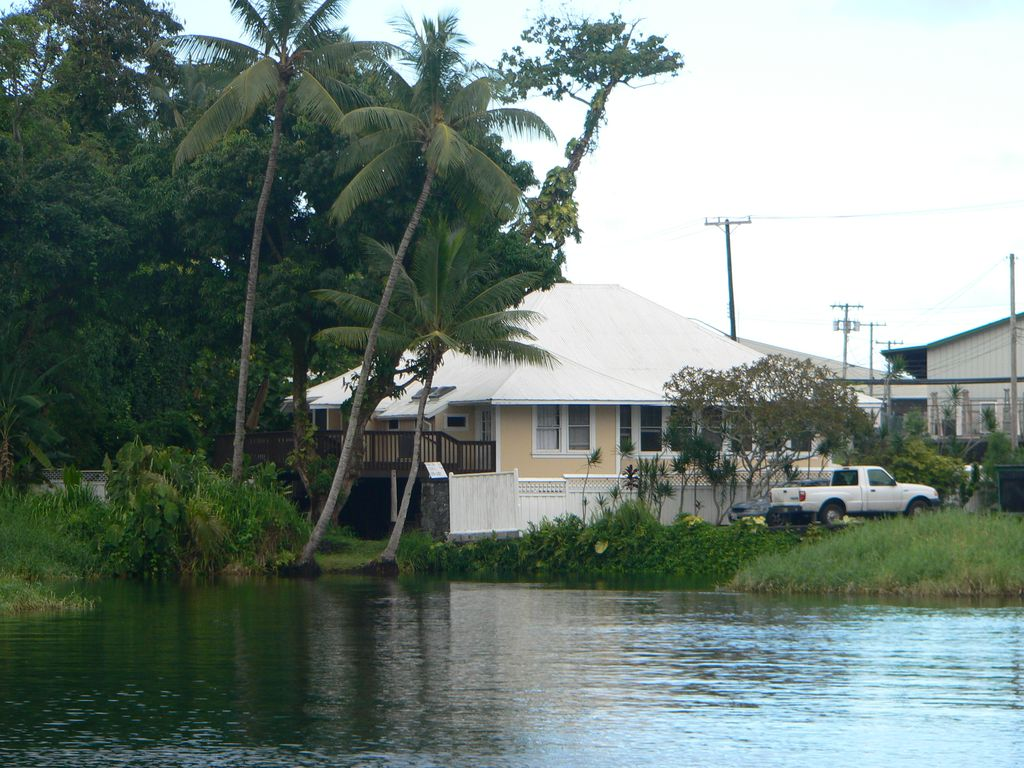 Waterfront in heart of Hilo, 1 block to hotels. Built on pond w/ fish & turtles.