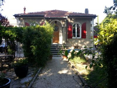 Photo for Quiet house with garden and jacuzzi area - 5 minutes from Avignon