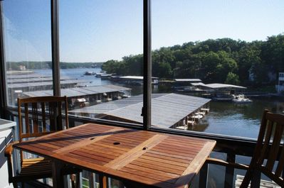 Lakeside Deck with clear sliding panels that have screening to the outside