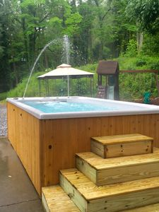 Photo for May 8-22 $475per nt. Go fishing, play in swim spa or walk to downtown Gatlinburg