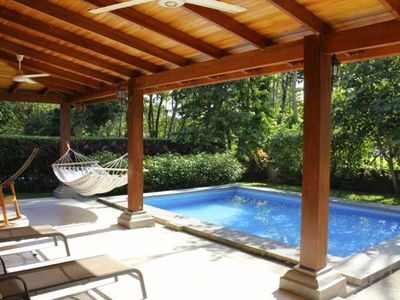 Enjoy the large covered deck and pool