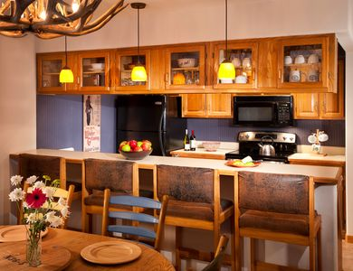 Take a seat at the breakfast bar or entertain at the dining room table.