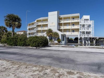 Photo for Quiet bay side condo with pool and fishing pier right on the water