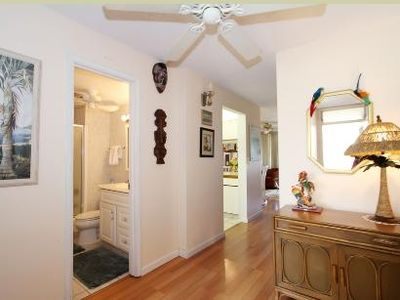 Photo for Centrally located, many recent updates, oceanview lanai, steps to beach