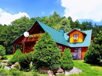 Photo for Holiday house with fireplace and sauna, located in the forest
