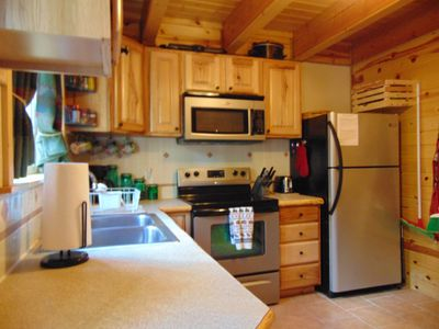 Kitchen with refrigerator, stove/oven, and microwave.