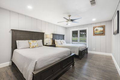 Second bedroom with two queen beds and USB ports on either side of headboard.