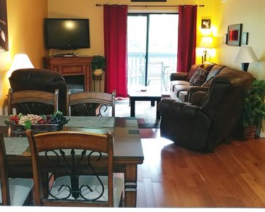 Living Room. Bonded Leather Sofa Sleeper, Recliners. LCD TV. Electric Fireplace