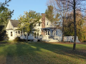 Idyllic 19th century farm house with 150 acres in easy reach of Montreal