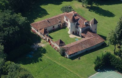 Photo for Seventeenth century manor house in the heart of the Périgord: piano, tennis court and heated pool