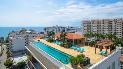 Photo for Newer ocean-view condo in lively Zona Romantica; Largest rooftop pool in Old Tow