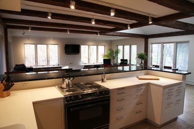 View from the kitchen, working vintage Jennair stove, corian/granite countertops