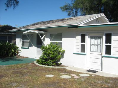 Photo for 1 bedroom private cottage right across the street from the beach!!!