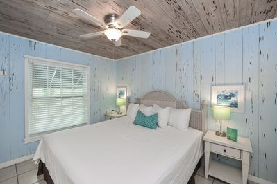 Suite 3 - 1-bedroom, king size bed. Beautiful pecky cypress walls and ceiling.