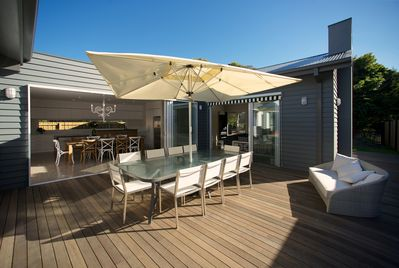 Sunny outdoor deck with BBQ