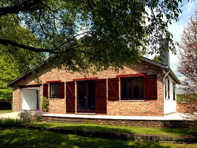 Photo for Cozy bungalow with large enclosed garden in the Western Ardennes