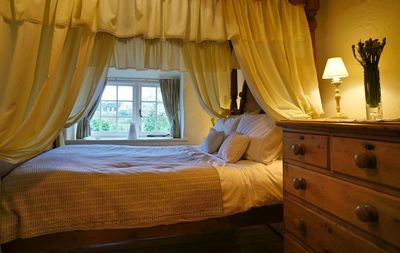 Romantic double bedroom with four poster bed