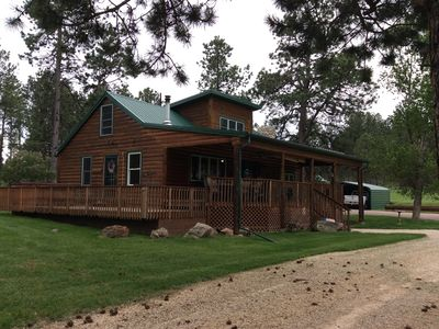 Photo for New Listing! Cozy Log Cabin And Bunkhouse On 60 Acre Ranch Surrounded By Forest!