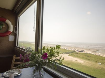Photo for This 3-room holiday apartment offers you on 65qm plenty of space for a holiday on the Cuxhaven coast. The glazed loggia offers incredible panoramic views of the Wadden Sea.
