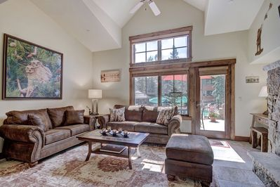 Enjoy the view of the outdoor patio from living room.