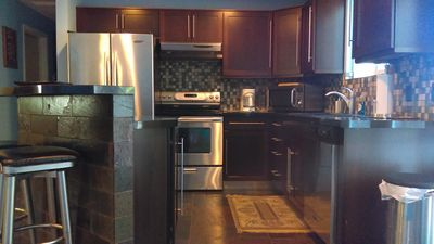 Kitchen stainless steel appliances coffee pot microwave fully loaded.