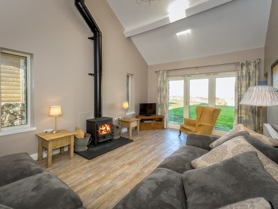 Photo for Set in a peaceful rural location, in generous shared grounds with extensive rural and coastal views,