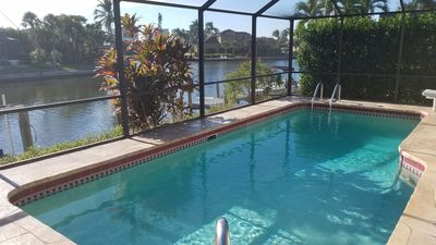 Photo for Waterfront Vacation Home–Enjoy Pool,Spa & Water Views–Walk to Beach !! 4 Bikes.