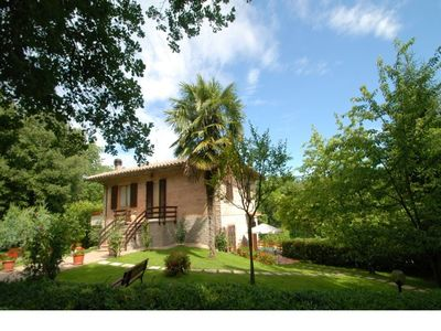 Photo for Spacious apartment with garden and pool middle way between Siena and Firenze