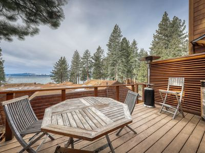 Photo for Charming condo close to town w/lake views, private grill, and wood fireplace!