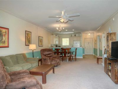 Photo for Comfortable ground floor, lake view condo w/ screened in patio!