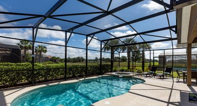 Photo for Fabulous Luxury Pool Home 6 bed 6.5 Bath  conservation view 15 mins to Disney